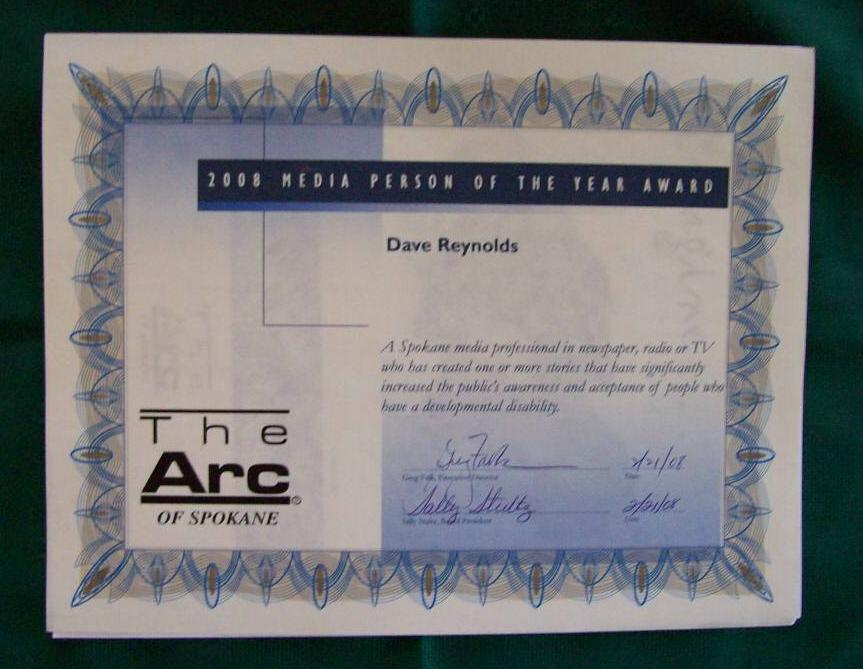 "blue text on white certificate, ""2008 Media Person of the Year Award, Dave Reynolds"""